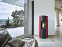 Zukunftssichere Heiztechnik für reduzierten Wärmebedarf: Holzfeuerung ideal für gedämmten Neubau